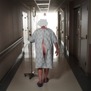 a_patient_in_hospital_gown_walking_-300x300